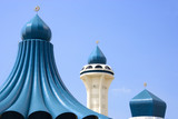 domes and minaret of a mosque poster