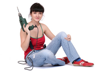 smiling woman with a drill