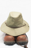 safari hat and hiking boots poster