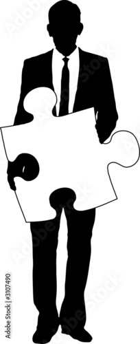 businessman holding jigsaw