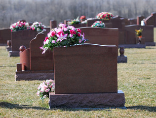 tombstones with flowers