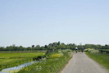 landscape with couple on the bike
