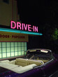retro drive-in and convertible at night