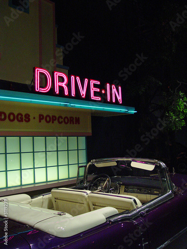 retro drive-in and convertible at night - 3119239