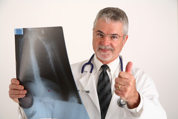 doctor with x-ray giving the thumbs up sign