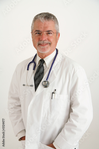 happy confident smiling doctor hands in pocket
