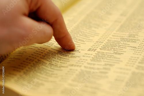 Leinwanddruck Bild phone book and a hand