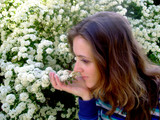 teen smelling flowers