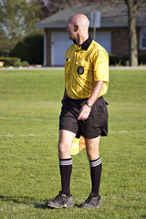 soccer official carefully watching the game