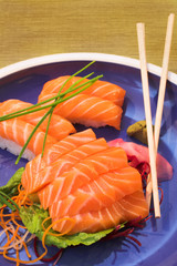 fresh sushi, sashimi and nigiri salmon on a plate