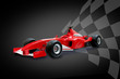 red formula one car and racing flag