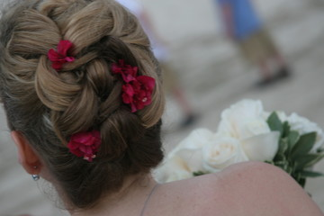 dark blond up-do with pink flowers