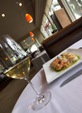 table in restaurant with gourmet food and wine poster
