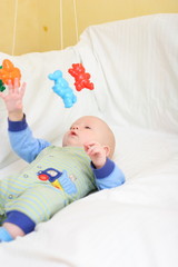 baby playing with toys. little boy touching the toy by finger.