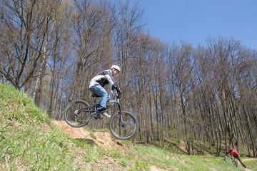 mountain biker jumps from a hill