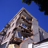 apartment building after earthquake poster
