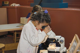child with microscope