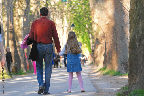 daugter and father walking in long alley