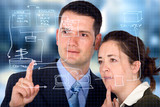 business partners analyzing a database structure poster