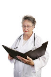 mature female doctor reviewing chart poster