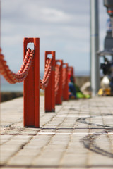 red chain fence by the sea