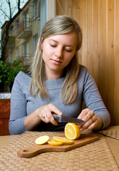 woman cuts lemon