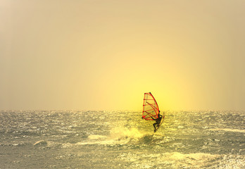 windsurfer jumping