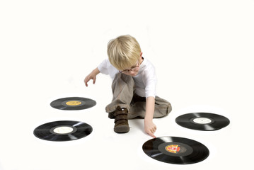 child with black vinyl