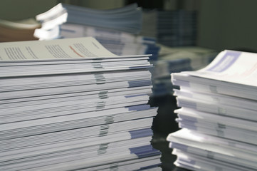 piles of handout papers