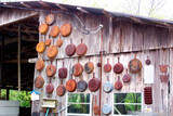 Rusted Cast Iron Skillets on Shed poster