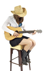 cowgirl playing her guitar