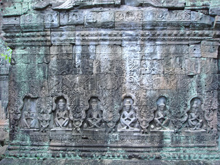 sculture of khmer art in old stone,  ta prohm, bayon, angkor tem