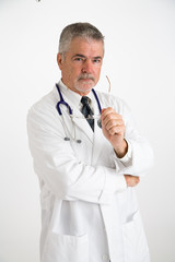 doctor holding eye glasses looking concerned
