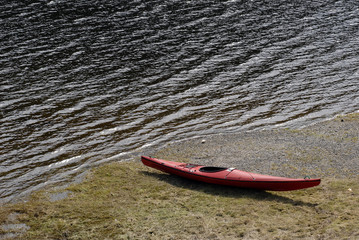 red kayak by the lake