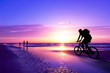 roleta: mountain biker on beach and sunset