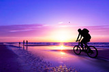 mountain biker on beach and sunset - Fine Art prints
