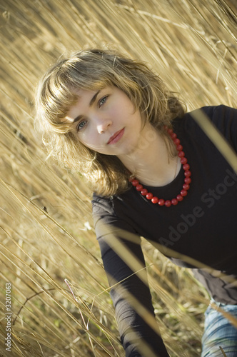 pritty blond sitting in the reed