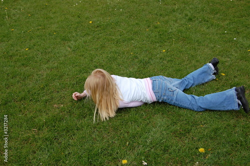 girl on grass with daisy flowers