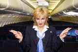 air hostess gesturing poster