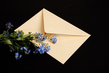 envelope with forhet-me-not flowers