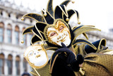 a joker with his mask at the venice carnival poster