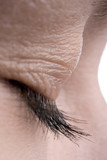 woman close-up eye eyelashes and skin poster