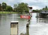 danger sign on a river poster
