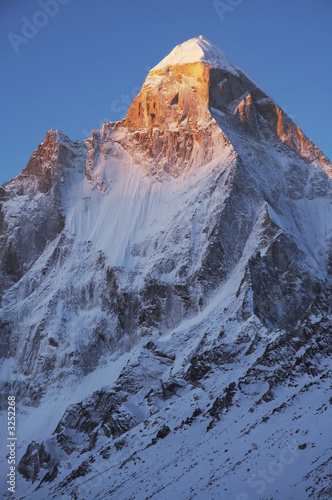 Leinwanddruck Bild shivling peak on sunrise