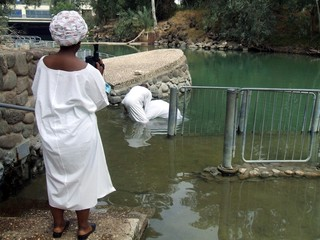 people baptizing in jordan river.holy land. israel