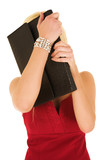 blonde businesswoman hiding behind folder poster