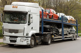 car carrier truck deliver new auto batch to dealer poster