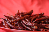 red hot chilli peper pods on scarlett-red poster