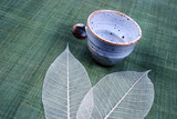 pottery cup and pretty spring leaves poster