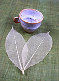 pottery cup and leaves poster